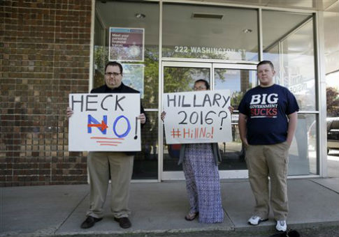 Protesters gather before a Hillary Clinton campaign event / AP