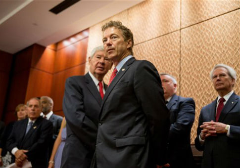 Sen. Rand Paul calls for the declassification of the redacted pages at a press conference. / AP