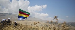In this photo taken on Tuesday, June 16, 2015, members of the Druze minority walk in Israeli-controlled Golan Heights as the fighting between forces loyal to Syrian President Bashar Assad and rebels in Druze village of Khader in Syria continues