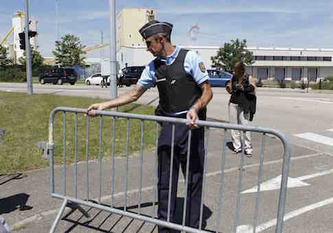 A French Gendarme blocks the access road to the Saint-Quentin-Fallavier industrial area