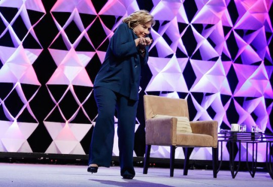 Hillary Clinton dodges a shoe.