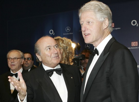 Bill Clinton chums it up with disgraced FIFA president Sepp Blatter. (AP)