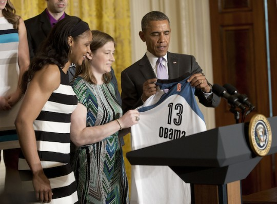 President Obama reluctantly accepts a WNBA jersey. (AP)