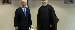Iran's President Hassan Rouhani, right, welcomes the International Atomic Energy Agency's director-general, Yukiya Amano / AP