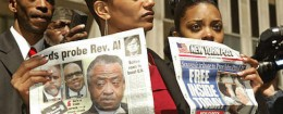 Rachel Noerdlinger talks to the press as Rev. Al Sharpton's director of communications in 2005 / AP