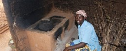 Lady preparing food on stove in hut, Rwanda / AP