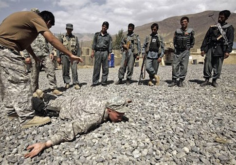 U.S. Army Sgt. William Womack, 23, from Batesville, Ga., of the 118th Military Police Co., based at Fort Bragg, N.C., is prone during a training session for the Afghan National Police at a combat outpost in the Jalrez Valley in Afghanistan's Wardak Province