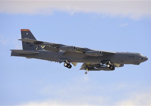 A Boeing B-52H Stratofortress prepares for landing.