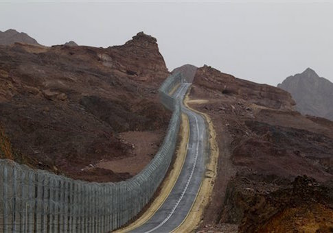 A street runs along the Egypt-Israel border security barrier near the Red Sea resort city of Eilat, southern Israel