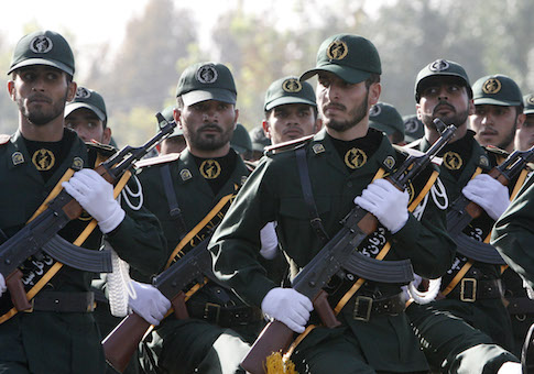 IRGC members march during a parade ceremony