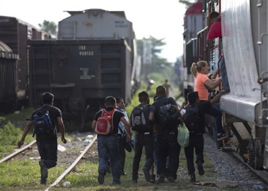 Immigrants journey toward U.S.-Mexico border