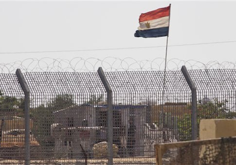 An Egyptian military officer watches at a post in Egypt's northern Sinai Peninsula, as seen from the Israel-Egypt border