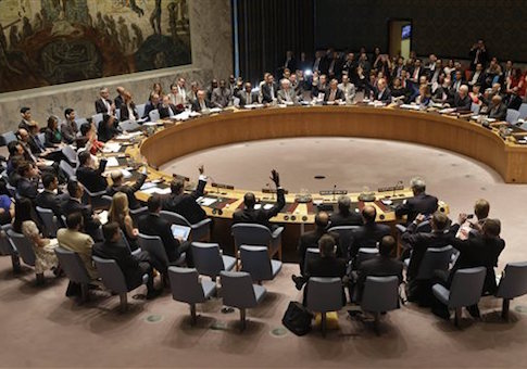 Members of the Security Council vote at United Nations headquarters, Monday, July 20, 2015. The U.N. Security Council unanimously endorsed the landmark nuclear deal between Iran and six world powers and adopted a series of measures leading to the end of U.N. sanctions that have hurt the Iranian economy