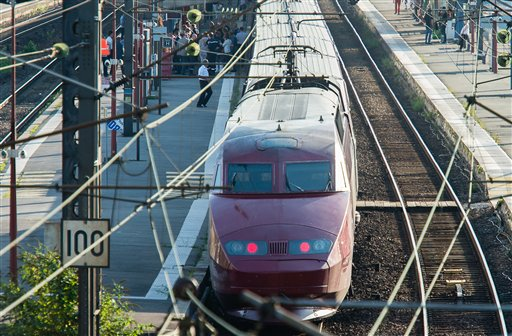 A Thalys train of French national railway operator, SNCF, stands at the main train station in Arras, northern France, after a gunman opened fire injuring three people / AP