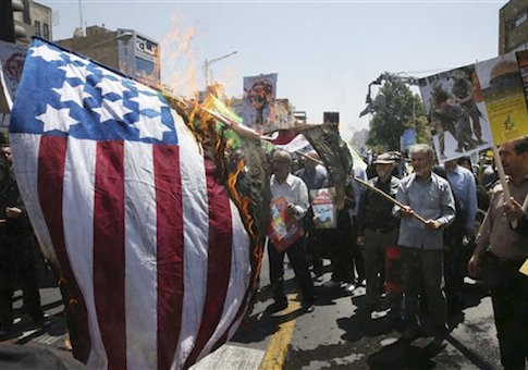 Iranian demonstrators burn a representation of the U.S. flag in an annual pro-Palestinian rally marking Al-Quds (Jerusalem) Day