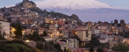 High angle view of Mt Etna over Cesaro cityscape, Messina, Sicily
