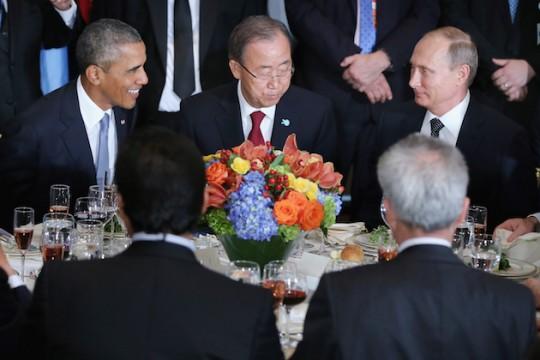U.N. Secretary General Ban Ki-moon holding President Barack Obama back from attacking Russian President Vladimir Putin / AP