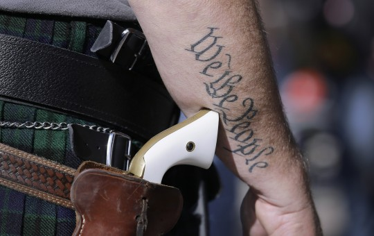 An open carry supporter at a Texas protest / AP