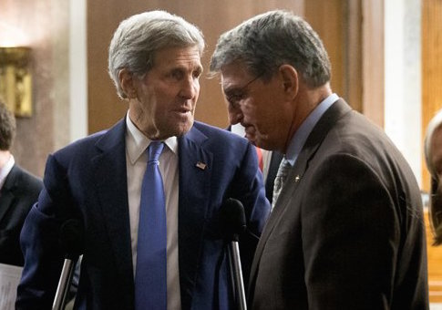 John Kerry and Sen. Joe Manchin