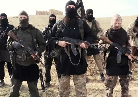 Islamic State fighters sending a video message / AP