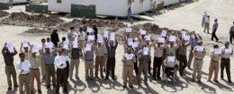 Members of MEK hold signs in Baghdad / AP