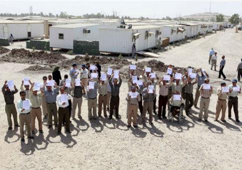 Members of MEK hold signs in Baghdad / AP