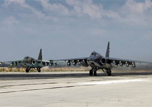 Two Russian SU-25 ground attack aircrafts take off from an airbase Hmeimim in Syria