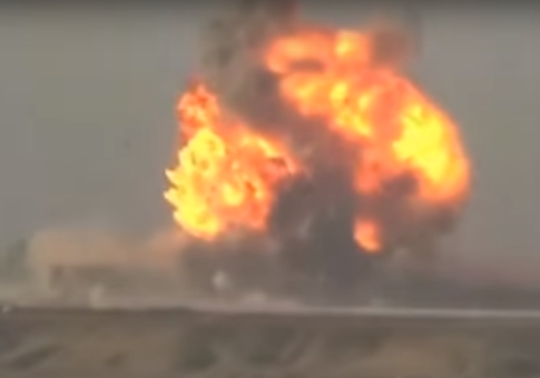 An Islamic State suicide fighter detonates a bomb with a U.S. Army Humvee (screenshot)