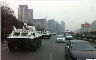 Armored personnel carrier dispatched by Bo Xilaito capture defector Wang Lijun