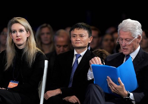 Elizabeth Holmes with former United States President Bill Clinton at the Clinton Global Initiative / AP