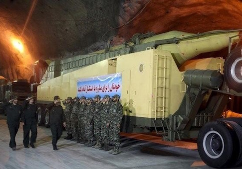 Members of Iran's Islamic Revolutionary Guard Corps' (IRGC) Aerospace Force salute at an underground missile base with launcher units in an undisclosed location / Reuters
