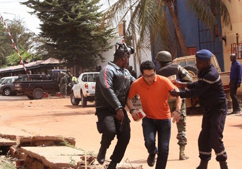 Mali troopers assist a hostage / AP