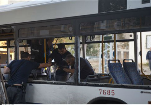 Police investigate the site of a bus bombing in Tel Aviv / AP