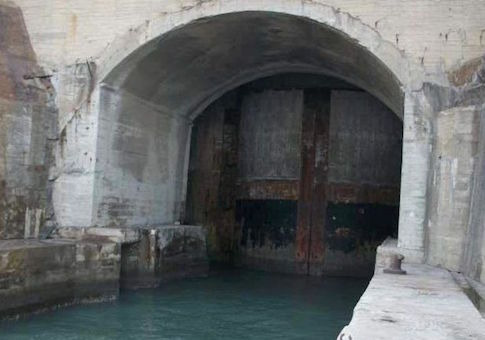 Recent Chinese military enthusiast websites have posted photographs of suspected Chinese submarine tunnels. In May, photos posted online showed the opening of a nuclear missile submarine cave at an undisclosed location.