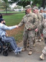 Soldiers line up to shake hands with Chris Mintz / AP