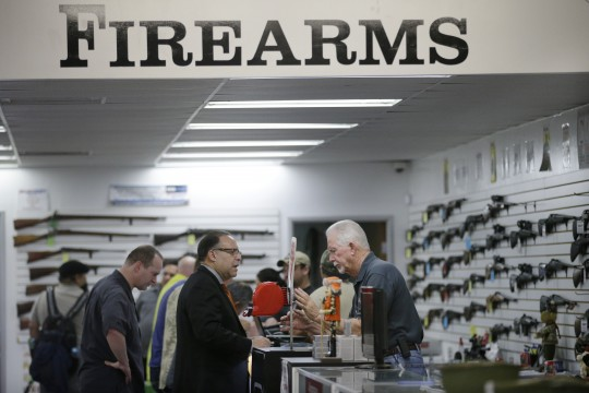 Customers at a California gun shop / AP