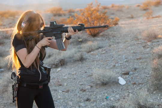 Attractive woman fires AR-15 / AP