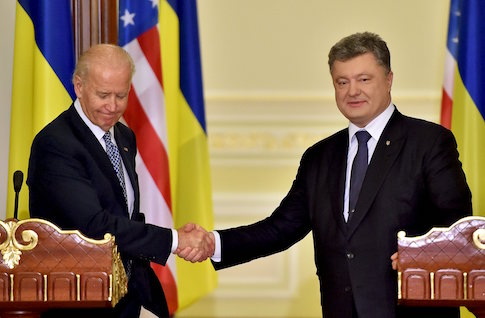 Ukrainian President Poroshenko shaking hands with U.S. Vice President Biden after their talks in Kiev / Reuters