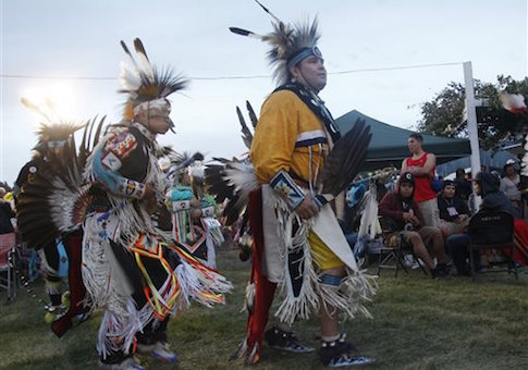 People perform during an event with the Fort Belknap Indian Reservation