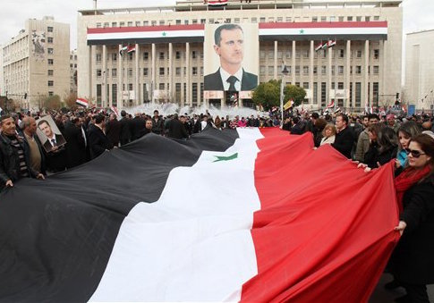 Pro-Syrian regime protesters in 2012 / AP