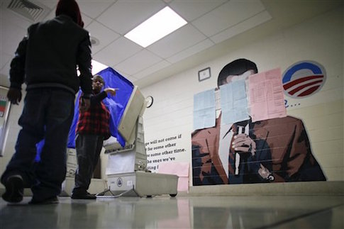 A Philadelphia polling place on election day in 2012, where a Barack Obama mural had to be covered due to complaints by Republicans / AP