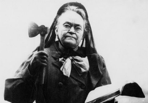 The famed temperance advocate Carrie Nation, with hatchet and Bible / Wikimedia Commons