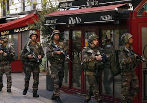French soldiers operate in St. Denis following Paris attacks / AP