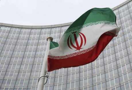 An Iranian flag flies in front of the International Atomic Energy Agency (IAEA) headquarters in Vienna / Reuters