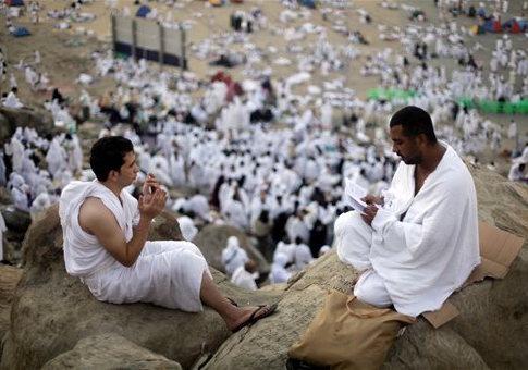 Muslim pilgrims pray near Mecca / AP