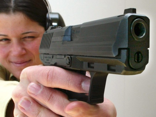 Woman with a gun / AP