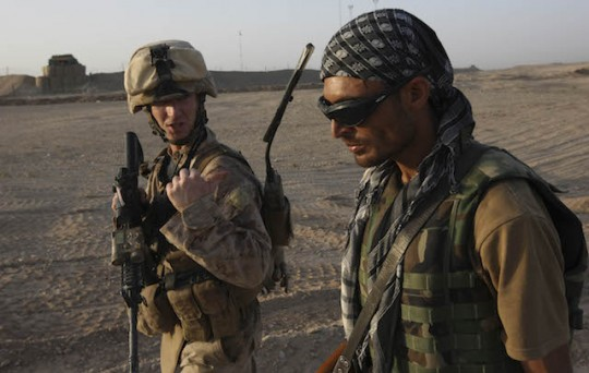 A U.S. Marine and an Afghan interpreter, 2009 / AP