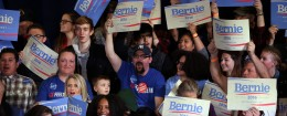 Supporters hold signs as Democratic presidential candidate, Sen. Bernie Sanders, I-Vt., is introduced during a rally  Feb. 19, 2016, in Reno, Nev. (AP Photo/Marcio Jose Sanchez)
