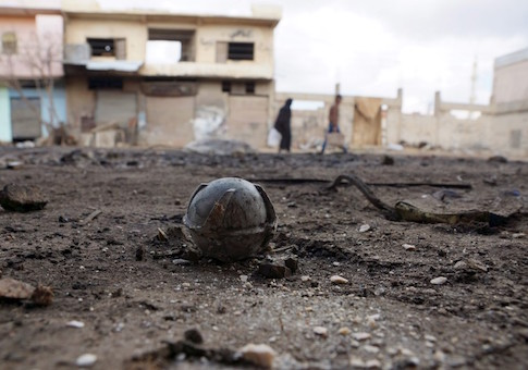 An unexploded cluster bomblet is seen along a street after airstrikes by pro-Syrian government forces in the rebel held al-Ghariyah al-Gharbiyah town, in Deraa province