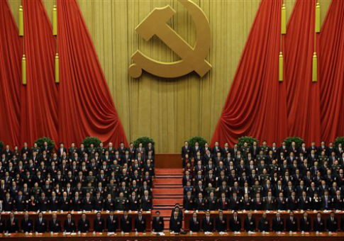 Chinese Communist Party leaders stand up while the international communist anthem is played. / AP